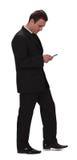 affärsman som kontrollerar den mobila telefonen Royaltyfria Foton