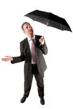 affärsman som kontrollerar, om regna Fotografering för Bildbyråer