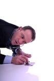 Affärsman som kontrollerar sjuka pengar Arkivfoton