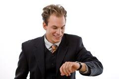 affärsman som kontrollerar tid Fotografering för Bildbyråer