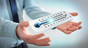 Affärsman som kontrollerar tolkningen för temperaturdroppe 3D Royaltyfri Foto