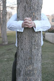 affärsman som kramar treen Royaltyfria Foton