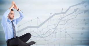 Affärsman som mediterar mot oskarp blå wood panel med grafen Arkivbilder