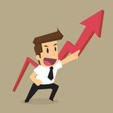 Affärsman som mer pekar upp pilen, vinsten och mer Arkivfoto