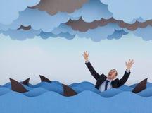 Affärsman som omges av hajar i det stormiga havet Royaltyfria Foton