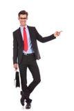 Affärsman som pekar fingret till hans vänster sida Arkivfoton