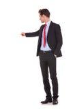 Affärsman som pekar på hans back Arkivfoton