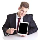 Affärsman som pekar på utrymme på Minnestavla-PC royaltyfri bild