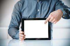 Affärsman som pekar till en tom skärm av en minnestavla royaltyfria foton