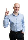 affärsman som pekar upp Royaltyfri Foto