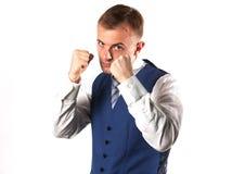 Affärsman som poserar visning att han är en kämpe Royaltyfri Bild
