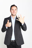 Affärsman som räknar nummer sex Arkivbilder
