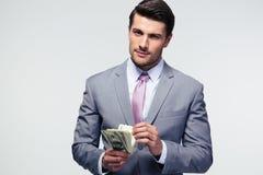 Affärsman som räknar US dollar Royaltyfria Bilder