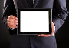 Affärsman som rymmer den digitala tableten Royaltyfri Bild