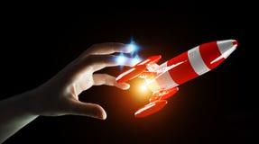 Affärsman som rymmer den röda raket i hans tolkning för hand 3D Royaltyfria Foton