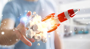 Affärsman som rymmer den röda raket i hans tolkning för hand 3D Royaltyfri Foto