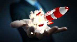 Affärsman som rymmer den röda raket i hans tolkning för hand 3D Arkivfoto