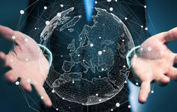 Affärsman som rymmer det globala nätverket på tolkning för planetjord 3D Arkivbild