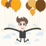 Affärsman som rymmer en ballong Fotografering för Bildbyråer