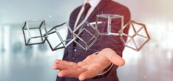 Affärsman som rymmer en blockchainkub för tolkning 3d isolerad på a Arkivbilder