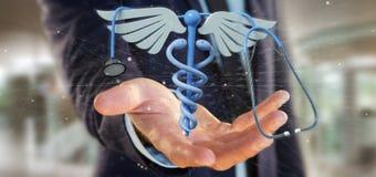 Affärsman som rymmer en 3d som redering medicinsk cadaceus och stethosco Royaltyfri Fotografi