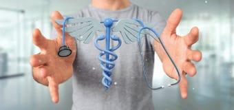 Affärsman som rymmer en 3d som redering medicinsk cadaceus och stethosco Royaltyfri Foto