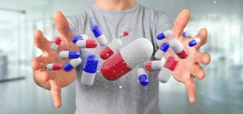 Affärsman som rymmer en grupp för tolkning 3d av medicinska preventivpillerar Arkivfoto