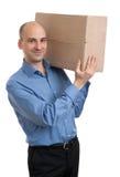 Affärsman som rymmer en packejordlott Royaltyfri Foto