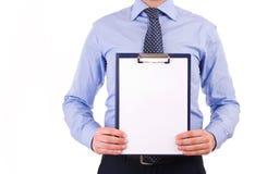 Affärsman som rymmer en skrivplatta. Royaltyfri Foto