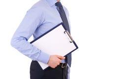 Affärsman som rymmer en skrivplatta. Arkivfoto