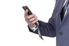 Affärsman som rymmer en telefon isolerad royaltyfri foto