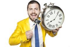 Affärsman som rymmer ett klocka- och valutasymbol Arkivbilder