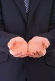 Affärsman som rymmer tomma händer. arkivfoton