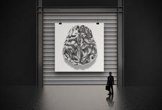 Affärsman som ser hjärnan för metall 3d Fotografering för Bildbyråer