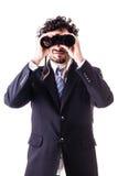Affärsman som ser med kikare arkivfoto