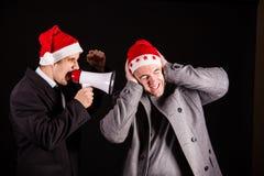 Affärsman som skriker i megafon Fotografering för Bildbyråer