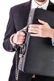 Affärsman som skyddar hans resväska arkivfoto