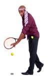 Affärsman som spelar tennis Royaltyfria Bilder