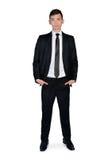 Affärsman som står allvarlig arkivfoto