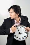 Affärsman som stjäler klockan Arkivfoto