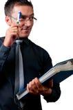 Affärsman som tänker och skrapar hans panna Arkivbild