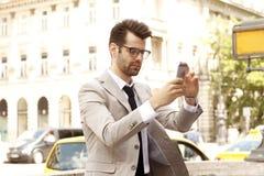 Affärsman som tar selfie Royaltyfria Foton