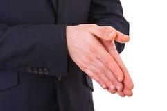 Affärsman som tillsammans gnider hans händer. Arkivfoto