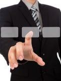 Affärsman som trycker på en imaginär skärm mot Arkivbild