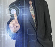Affärsman som trycker på knappar royaltyfria foton