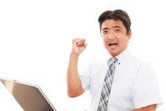 affärsman som tycker om framgång arkivbilder