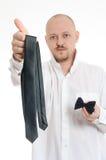 Affärsman som väljer tien eller flugan Arkivfoto