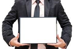Affärsman som visar mappblocket Arkivbild