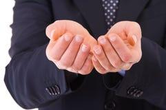 Affärsman som visar tomma händer. royaltyfri foto