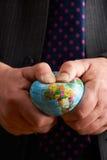 Affärsman Squeezing Globe Over Afrika Fotografering för Bildbyråer